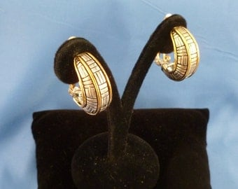 Gold and Silver Detailed hoop clip earrings.