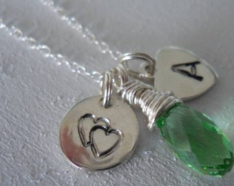 Heart stamped in sterling silver, perfect for your Valentine...Swarovski peridot crystal and a stamped initial of your choice