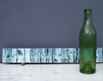 Vintage green glass bottle.