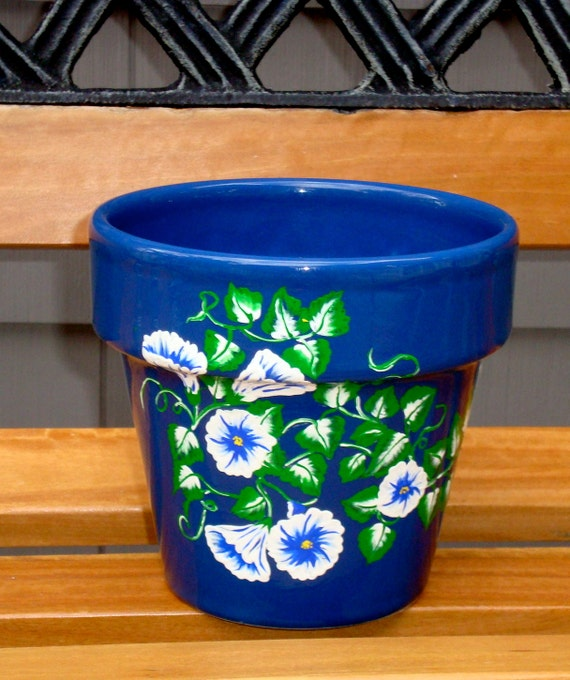 Blue Flower Pot Planter with Blue and White Flowers