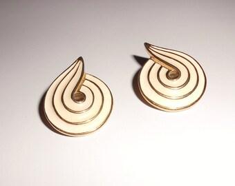 Vintage pierced earrings by Trifari 1970s cream enamel swirls abstract pierced gold tone metal earrings