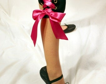 Girls dance clothes, dancewear, lace-up capri pants, black with grommets and pink double-sided satin ribbon