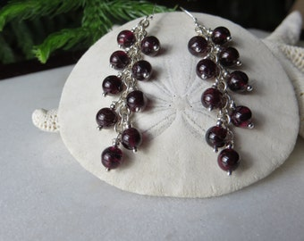 Garnet cluster earrings, January birthstone earrings, nine garnet rounds hung on each sterling silver chain