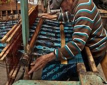 Weaving on a floor loom in Salcaja, Guatemala- a color photograph