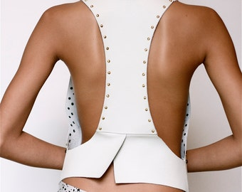 Leather vest with studs.