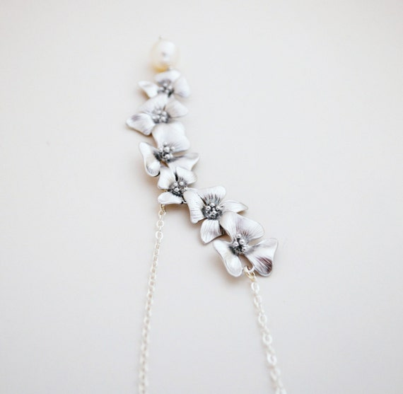 elongated silver cherry blossom necklace by