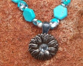 Children's turquoise necklace with silver flower concho with crystal centerpiece.