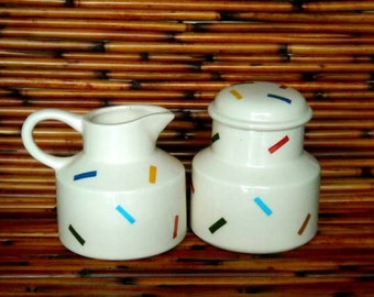 White Earthenware Ceramic Hand Made African Queen Design Sugar Bowl and Creamer Set