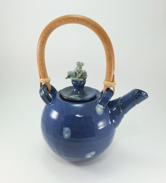 teapot with a frog