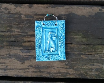 Playful Pup Holding Basket Tile in Ocean Blue