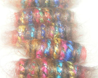 We started the month with a burst of passion but lately we've felt like Ferdinand in a field of flowers. Fiber Bead, dread loc tube, slide