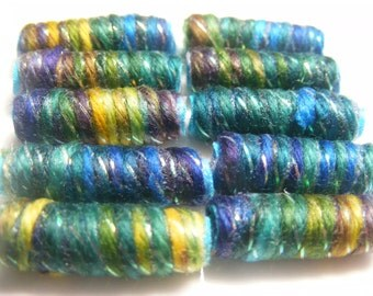 Once you are born beautiful it just goes on and on. There is not one joyless bead in this condo. Fiber Beads, Textile artisan dread tube