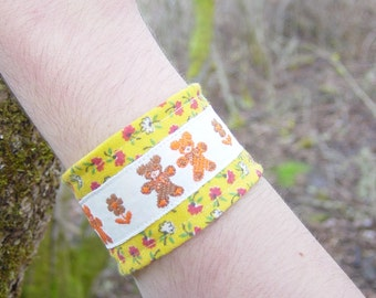 Fabric cuff/ wristband/ armband/ bracelet in vintage reclaimed materials( yellow, orange , and brown teddy bears)