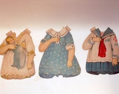 vintage paper doll clothing. each piece is approximately 7 inches tall and 5 1/4 inches  wide.