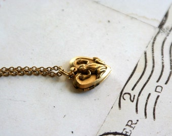 frog. heart locket necklace. gold ox