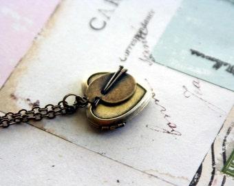 artist. locket necklace. in brass ox
