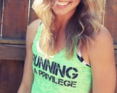 Running is a Privilege.  Burnout A-Line Racerback Tank.  Sizes S-XL.