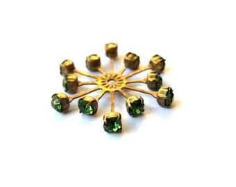Vintage SWAROVSKI flower bead 32mm green crystals in brass setting  genuine 1100 made in Austria