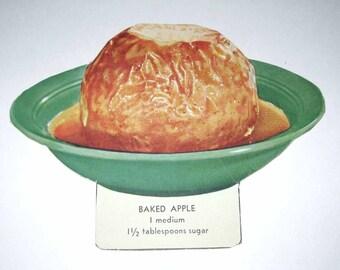 Vintage Food or Nutrition Die Cut Cardboard School Decoration of a Baked Apple in a Bowl