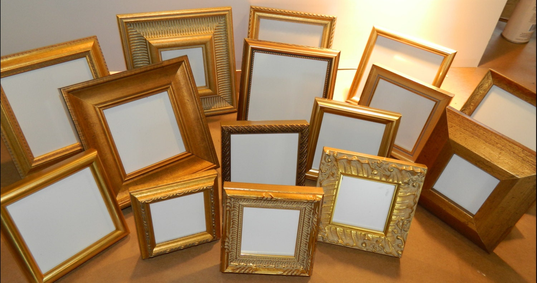 lot of 15 small gold frames wedding reception tables. Black Bedroom Furniture Sets. Home Design Ideas