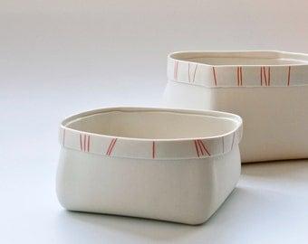 porcelain serving bowl with red orange stripes (Medium). contemporary ceramic fruit bowl. Design By Wapa Studio