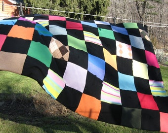 100% Cashmere Quilt with recycled cashmere.