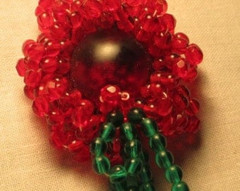 Red Beaded Flower pin brightens any spring day