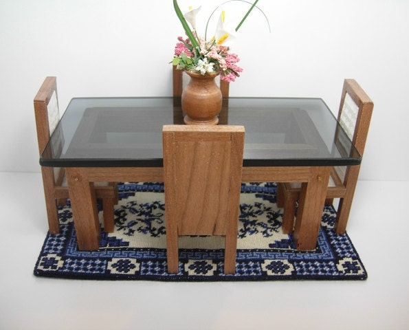 Miniature dining table chairs rug and floral centerpiece in