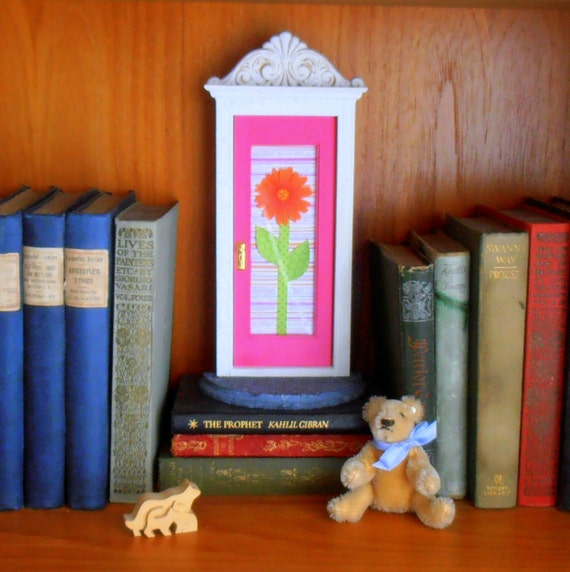 Fairy Door in pink, with orange flower embellishment and architectural detail