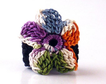 Crochet Ring Fiber Ring  Flower Applique Indigo Blue Orange Ecru Purple Green on a Black Band
