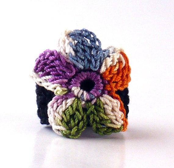 Crochet Ring Fiber Ring  Flower Applique Indigo Blue Orange Ecru Purple Green on a Black Band