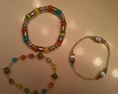 A Trio of Multicolor Glass and Silver Beaded Bracelets
