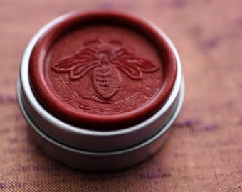 Aurora Solid Natural Perfume in a Round Tin with signature, color coded honey bee wax seal - Oriental fragrance with spice and floral notes