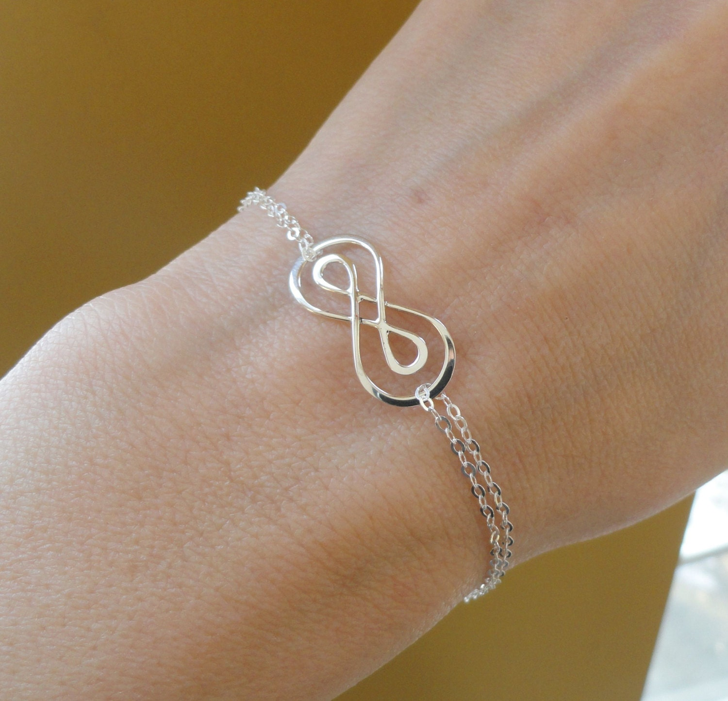 silver double infinity symbol bracelet figure by briguysgirls. Black Bedroom Furniture Sets. Home Design Ideas