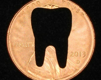 Lucky penny with tooth cut out