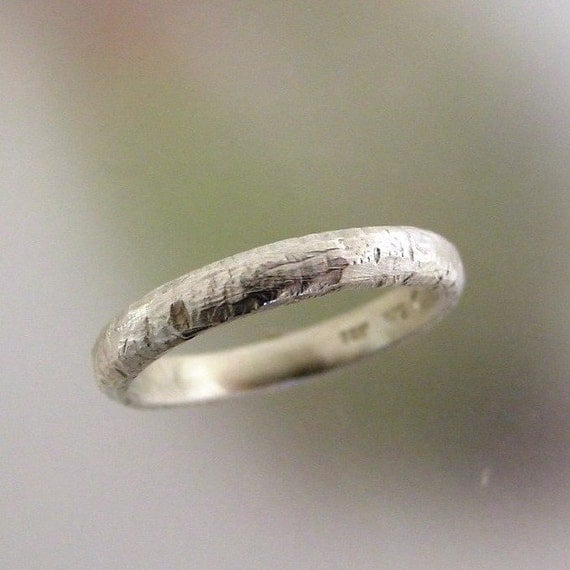 Mens rustic wedding ring of nickel free sterling silver. Tool marks and textures give this band a slightly a primitive look and feel. The band is 3.5mm wide and