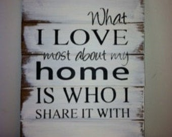 "What I love most about my home is who I share it with 13""w x17 1/2""h Hand-painted wood sign"