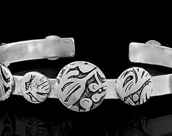 Etched silver cuff bracelet.