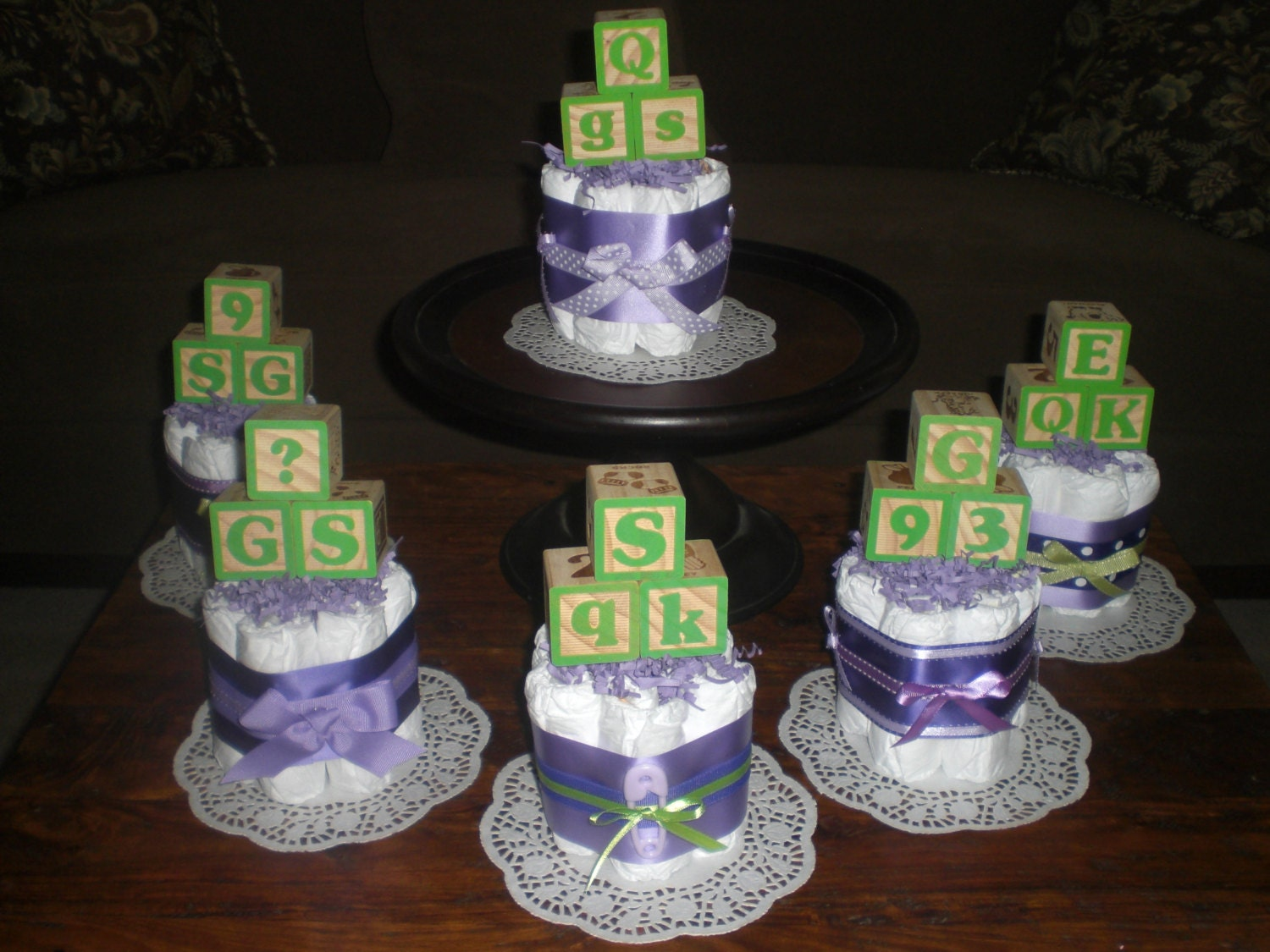 purple and green baby shower centerpieces by bearbottomdiapercakes