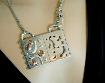 Sterling Silver and copper necklace copper swirls hand sawn -handmade-metalsmith work-one of a kind