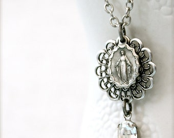 Antique silver Miraculous Medal necklace.  Vintage glass rhinestone and lacy filigree.  Religious keepsake.