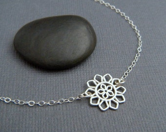 silver flower necklace. simple silver necklace. sterling silver. simple. modern filigree. nature. delicate. everyday. dainty jewelry 1/2""