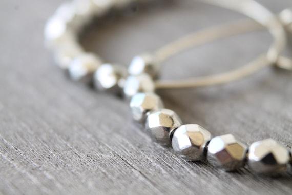 Metallic silver beaded hoop earrings