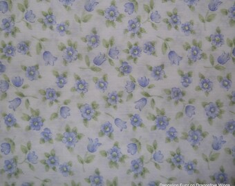 One Yard of Blue Flowers on a Light Blue Background