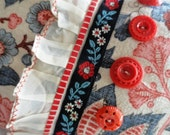 Pillow handmade from vintage fabric and trims, plus buttons, reversible, red, white, and blue