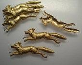 6 brass running fox charms