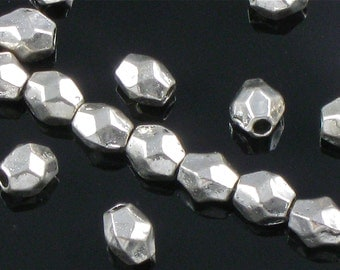 100 faceted metal spacer BEADS in Silver. 4mm x 3mm