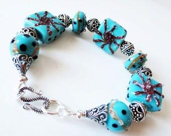 Turquoise bracelet.  Blue green bracelet.  Lampwork bracelet.  Teal bracelet.  Bali silver bracelet.  Starfish bracelet.