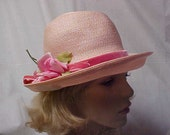 "Reserved-Linda Pink poly straw hat with pink velvet band and side rose with designer label "" Sandra"" NY and union label- fits 22 inches"