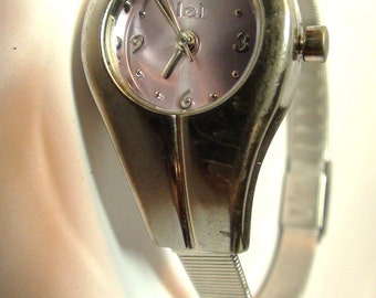Lei Wrist Watch Silver tone and Purple Face with Silver  Bracelet Vintage from 1981 is working New Battery